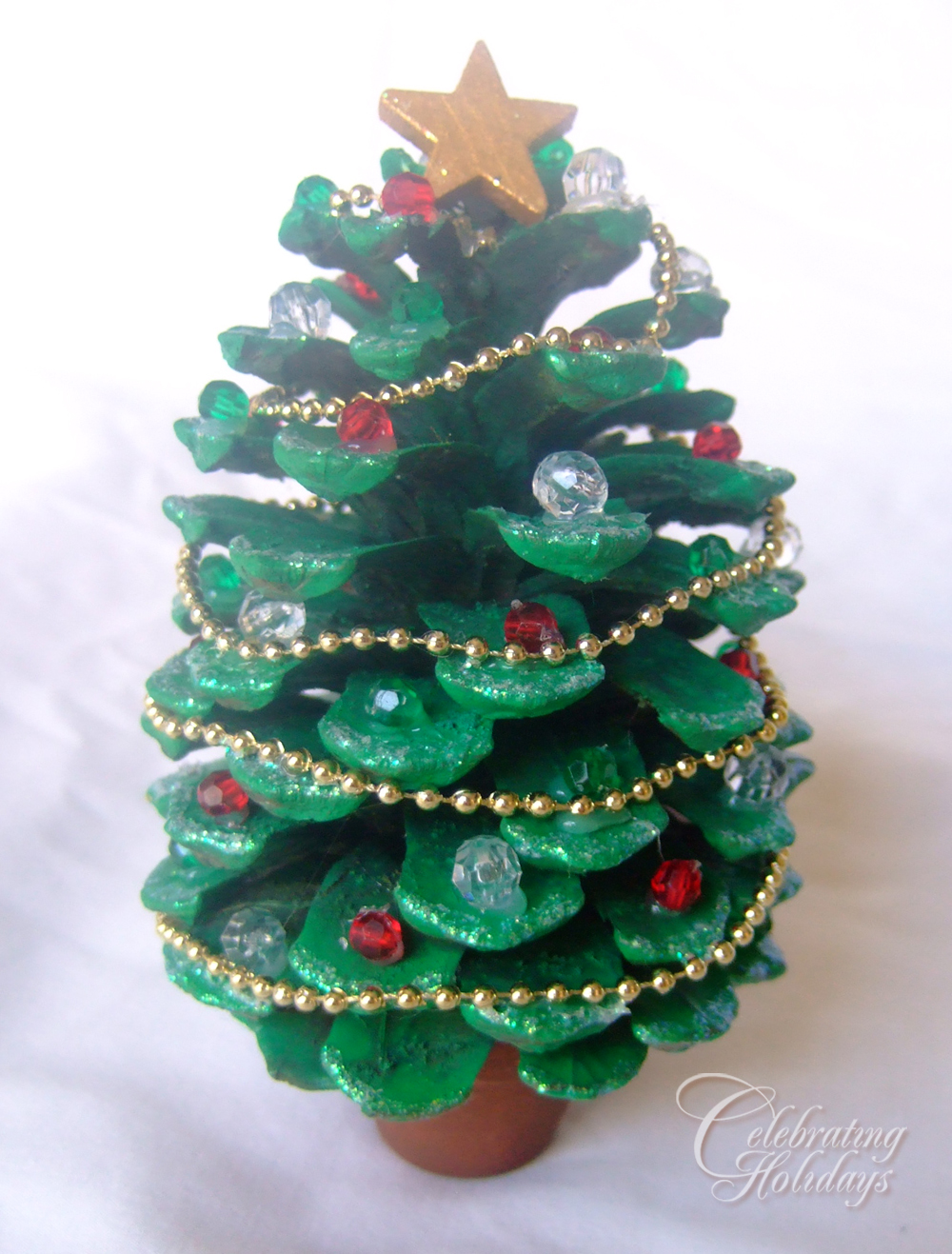 Pinecone christmas tree craft celebrating holidays for Pine cone christmas tree craft